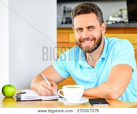Man Sit Eat Green Apple Fruit. Coffee And Fruit Recharge Energy Reserve. Healthy Habits. Healthy Man