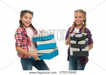 Kids Little Girls With Braids Hairstyle Hold Piles Gift Boxes. Children Excited About Unpacking Gift
