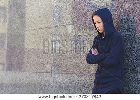 Depressed Sad Teenage Boy On A Dark Background, Teenage Problem Concept