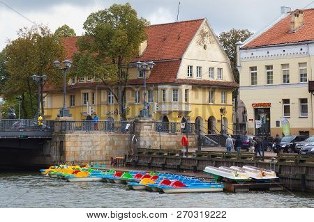 Klaipeda, Lithuania - September 22, 2018: Parking Of The Water Bicycles On A Dane River In Historica