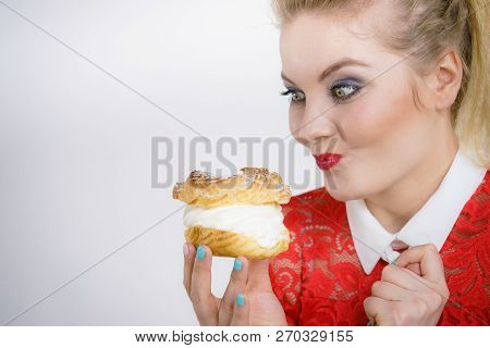 Woman Holding Sweet Cupcake Cake Dessert With Cream, She Wants To Eat It.