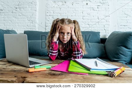 Sweet Little Schoolgirl Having Trouble With Computer And Homework At Home
