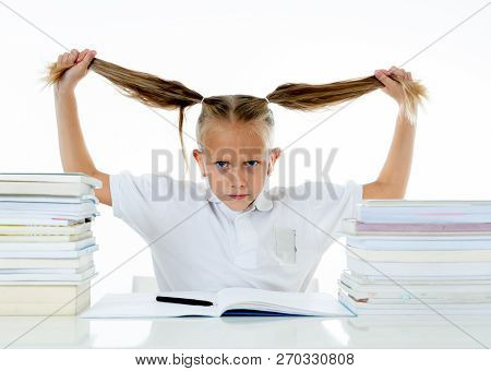 Stressed School Girl Feeling Frustrated And Unable To Concentrate In Her Studies