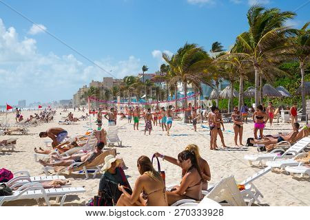 Mexico, Cancun - February 15, 2018: People Playing Volleyball At The Cancun Beach. Ocean View And Sa