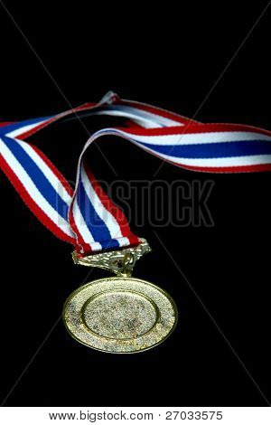 isolated Blank gold medal with tricolor ribbon