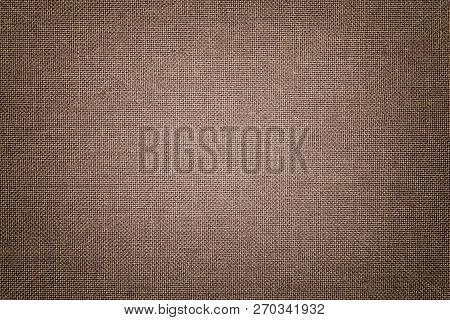 Dark Brown Background From A Textile Material With Wicker Pattern, Closeup. Structure Of The Light B