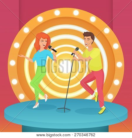 Couple, Man And Woman Singing Karaoke Song With Microphone Standing On Circle Modern Stage With Lamp