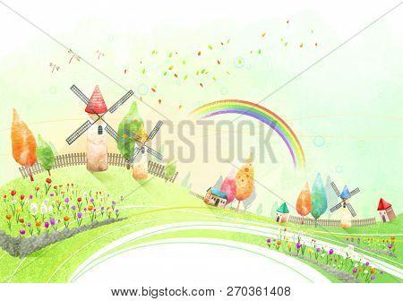 Windmill farm with rainbow in sky