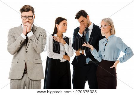 Guilty Worried Businessman With Colleagues Behind Isolated On White