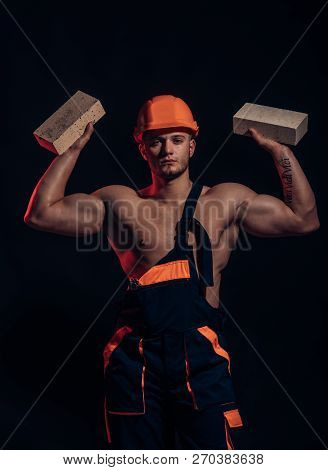 Building Up Great Things. Construction Worker Or Builder At Work At Building Site. Bricklayer Worker