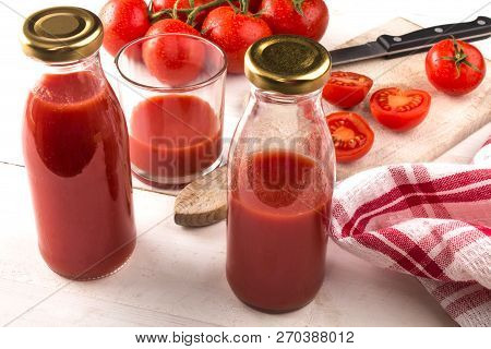 Home Made Organic Tomato Juice In A Glass And Bottle