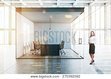 Side View Of Office Meeting Room With White And Glass Walls, Concrete Floor, Long Black Table With B