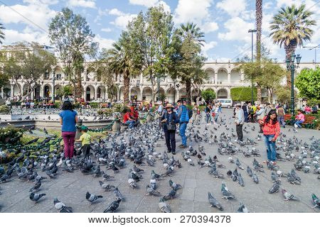 Arequipa, Peru - May 26, 2015: People And Pigeons At Plaza De Armas Square In Arequipa, Peru.