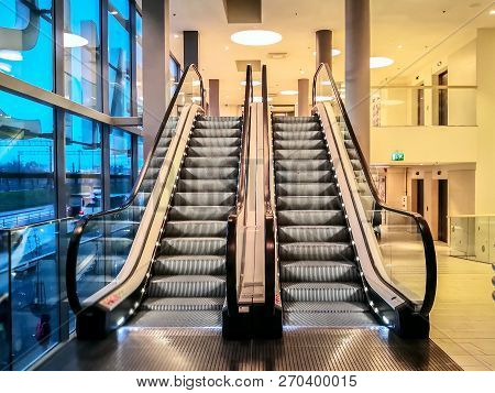 Empty Modern Stairs Or Escalators At The Modern Shopping Mall. Background Of Moving Escalator In The