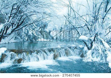 Croatia, Plitivice, Frozen Waterfalls In Popular Nature Park Plitvicka Jezera