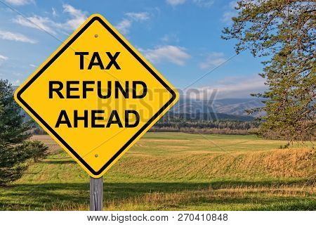 Tax Refund Ahead Caution Sign With Springtime Background
