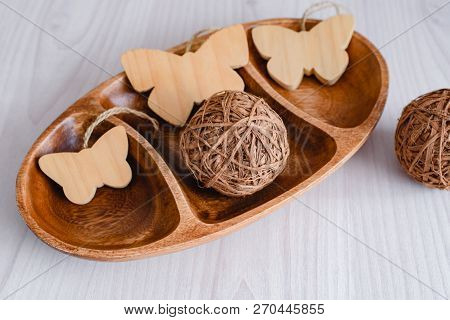 Still Life Of A Wooden Salad Bowl Of Three Sections, Wooden Decorative Butterflies And Wooden Decor