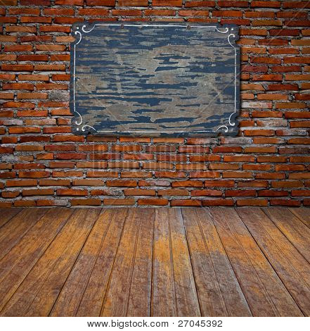 Frame or board on brick wall and wood floor