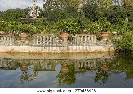 Fountain In The Boboli Garden In Florence With A Pond With Green Water, Italy.