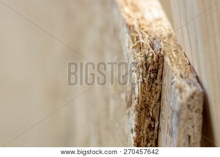 Pressed Wooden Osb Panel. Background Texture Of Wooden Osb Board Butt Ends Stacked, Close Up.