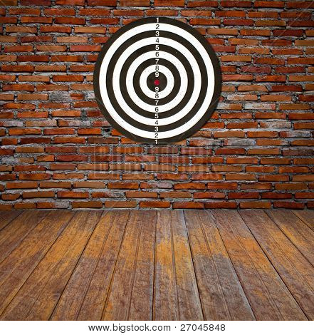 Dartboard on brick wall