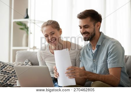 Happy Husband And Wife Excited Receiving Positive Bank Notice