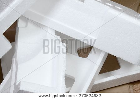 Background Image With Beige Cardboard Paper And Styrofoam Boxes Disgarded As Rubbish. The Concept Of