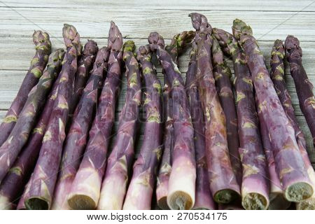 Purple Asparagus Background With Copy Space As A Header.