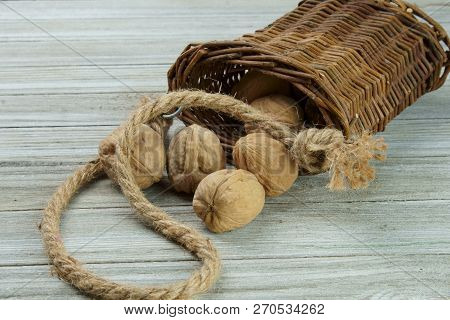 Walnuts In A Wooden Basket With Copy Space.