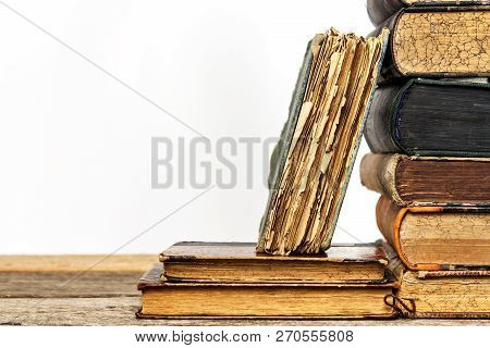 Old Books On A Wooden Shelf On A White Background. Study Of Old Books. Damaged Books. Old Library.
