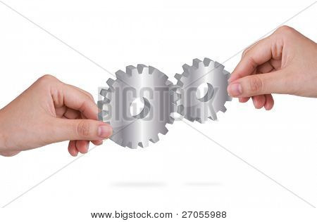 Two hand holding gears of success