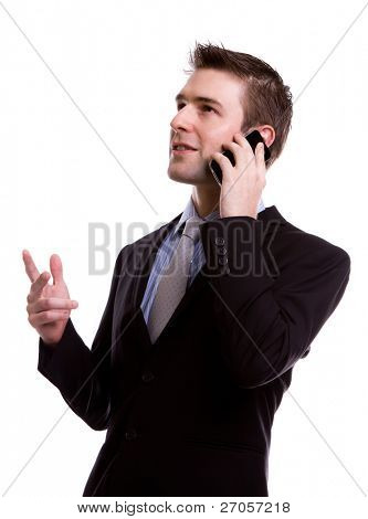 Portrait of young business man on the phone against white background