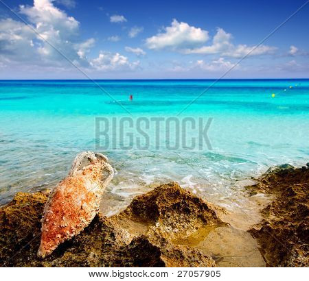 Amphora roman clay pottery with marine fouling in Mediterranean rock beach [ photo-illustration]