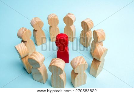 A Crowd Of Workers Stand In A Circle And Listen To Their Mentor, Leader Or Ceo.the Concept Of Leader