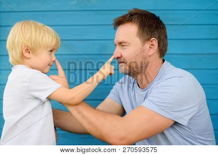 Cute Little Boy And His Father Pressed Finger On Each Other's Nose