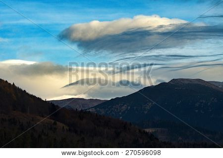 Wind Game Over Clouds Over Mountain Chain Žiarska Hoľa. Cloudy Clouds Create Beautiful Color And Sha