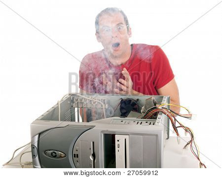 heavy smoke emerging from the computer the technician is surprised