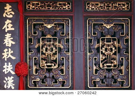 ornaments on chinese Cheng Hoon Teng temple door, Melaka, Malaysia