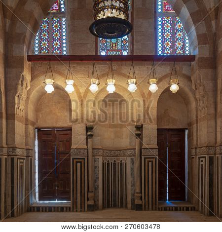 Cairo, Egypt - November 3 2018: Marble Wall With Mihrab (niche), Two Wooden Doors, Huge Arches And S
