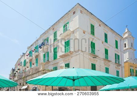 Molfetta, Apulia, Italy - Turquoise Sunshades And Lattice Blinds In The Streets Of Molfetta