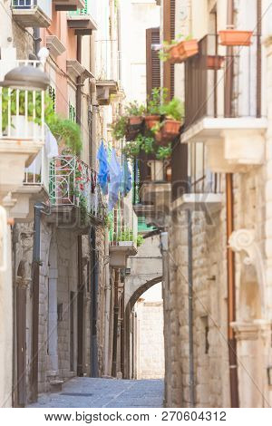 Molfetta, Apulia, Italy - Old Balconies And A Historical Archway In An Alleyway Of Molfetta