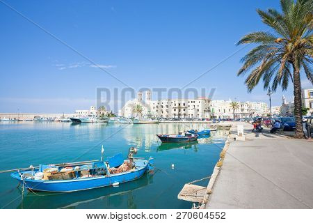 Molfetta, Apulia, Italy - June 3, 2017 - Traditional Fishing Boats At The Harbor Promenade Of Molfet
