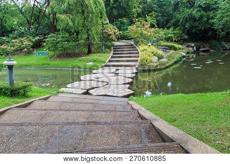 Beautiful Stone Bridge Across The Lake In Sirikit Park Bangkok / Thailand 05-13-2018