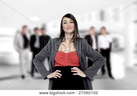 Portrait of successful businesswoman and business-team at office meeting