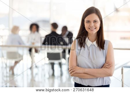 Millennial Female Team Leader Posing In Modern Office, Portrait