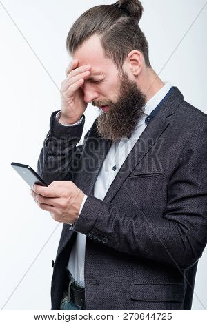 man grasping head and holding phone. failure and emotional reaction to bad news. poster