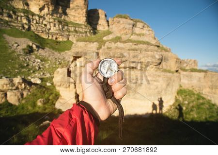 First-person View Seeks Direction With A Compass In Hand In The Summer Mountains. Search By Destinat
