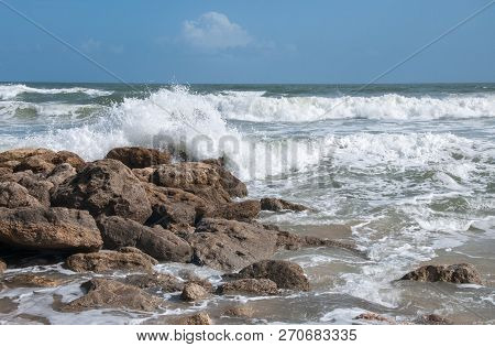 Waves Crash On A Rocky Beach In Florida.