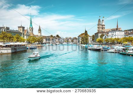 Panoramic View Of Zurich City Center With Churches And Boats On Beautiful River Limmat In Summer, Ca