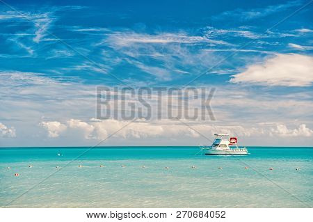 Boat At Marine Beach Of Antigua St. Johns With Boat On Blue Water And Sky With Small Clouds